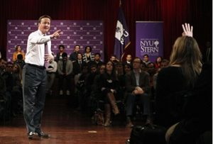 British Prime Minister David Cameron calls on an audience member during a question and answer session at New York University's Leonard N. Stern School of Business on the NYU campus in New York City, March 15, 2012. REUTERS/Mike Segar   (UNITED STATES - Tags: POLITICS)